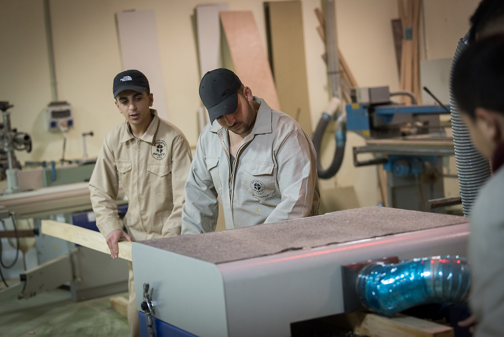 25 February 2020, Jerusalem: Mohammad Skafi (left) and Mahmoud Akil (right) train to become carpenters. The Lutheran World Federation's vocational training centre in Beit Hanina offers vocational training for Palestinian youth across a range of different professions, providing them with the tools needed to improve their chances of finding work.