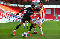 Middlesbrough's Djed Spence holds off the challenge from Stoke City's Morgan Fox<br /> <br /> Photographer Alex Dodd/CameraSport<br /> <br /> The EFL Sky Bet Championship - Stoke City v Middlesbrough - Saturday 5th December 2020 - bet365 Stadium - Stoke-on-Trent<br /> <br /> World Copyright © 2020 CameraSport. All rights reserved. 43 Linden Ave. Countesthorpe. Leicester. England. LE8 5PG - Tel: +44 (0) 116 277 4147 - admin@camerasport.com - www.camerasport.com