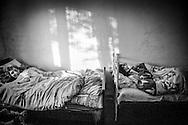 Astrik and her ill daughter remain bedridden in their house. Tsoghamarg. 2008 .