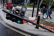 Traffic lights have been accidentally knocked over by the unsighted driver of a reversing articulated lorry on Leadenhall in the City of London, the capital's financial district, on 24th May 2021, in London, England.