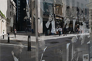 Merging with party images of the Rat Pack in the window of a menswear outfitters, are the reflection of a City workers and pedestrians in Lime Street in the City of London, the capitals financial district, on 21st August 2020, in London, England.