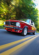 Image of a red 1973 BMW 2002 hot rod on a country road, Oregon, Pacific Northwest by Randy Wells