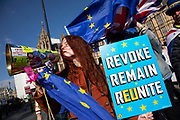 Young anti Brexit protester Florine Pochet from Lille in France shouts anti-Brexit slogans with other protesters opposite Parliament in Westminster as the Prime Minister arrives in Brussels to request an extension to Article 50 so the UK can continue to try to agree a Brexit Withdrawal Agreement on 10th April 2019 in London, England, United Kingdom. With just two days until the UK is supposed to be leaving the European Union, the delay decision awaits.