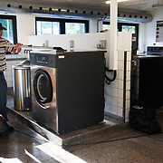 Early morning clean of the communial laundrette.  Lundtoftegade is a housing estate in the heart of Copenhagen. The estate has been on the controversial Ghetto List for years but wastaken off 1st of December 2020. The Ghetto List is based on the Ghetto Law introduced by the Danish Govenrment in 2018. In 2020 a huge campaign was launched to raise 50.000 signatures demanding the Danish Parliament to reconsider the law and to abolish it. Part of the campaign was the national portrait poster campaign 'We ARE the mixed city'. More than 100 local residents in joined the campaign and were photographed in a small make shift studio set up in Lundtoftegade. These images are fragments of life in and around Lundtoftegade 2020.