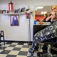Grants mayor Modie Hicks receives a haircut from Clorinda Brito at Clo's Hair Design in Grants Thursday. Hicks had his hair cut after a fundraiser to benefit the Marine ROTC drill team trip to a national competition.