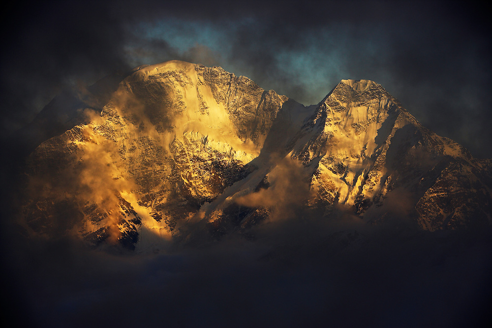 Russia, Caucasus, last light on Donguzuron mountain (4468 m asl) (left) and Makratau (4269 m asl) (right), seen from Elbrus.