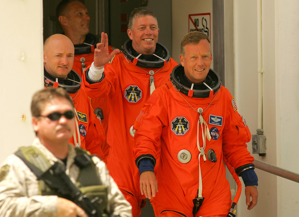 Space Shuttle Discovery launch, STS-121.Commander Steve Lindsey (right), Mission specialist Michael Fossum (center), and Pilot Mark Kelly walk towards the van that will take them to launch pad 39-B on Saturday, July 1, 2006.