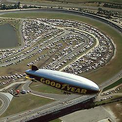 Aerial photograph of the Good Year blimp over the Daytona Interantional Raceway during a race. 1995