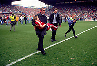 A Young Liverpool Fan is carried away to safety.<br />