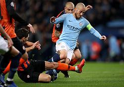 Shakhtar Donetsk's Taras Stepanenko (bottom left) fouls Manchester City's David Silva