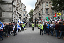 © Licensed to London News Pictures. 09/09/2015. London, UK. Pro-Palestinian protestors (R) are held back by police as Israeli demonstrators (L) stand outside the gates of Downing Street ahead of a visit by Israeli Prime Minister Benjamin Netanyahu. Photo credit: Peter Macdiarmid/LNP