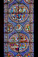 Medieval stained glass Window of the Gothic Cathedral of Chartres, France - dedicated to the Life of St Mary Magdalen. Central panel - top left - Mary meets the angel at Christ's empty tomb (the Quem quaeritis), bottom right - The Noli me tangere, top left - Mary as the Apostola Apostolorum , top right - The Apostles receiving Mary's news . Diamond below and side panels either side - Christ raising Lazarus. Bottom central panel - bottom left - Mary washing Christ's feet in the house of Simon the Pharisee, bottom right - Death of Lazarus, top left - Their neighbours try to console Mary and Martha, top right - Funeral of Lazarus. Diamond panel above and side panels either side - Christ raising Lazarus. A UNESCO World Heritage Site. .<br /> <br /> Visit our MEDIEVAL ART PHOTO COLLECTIONS for more   photos  to download or buy as prints https://funkystock.photoshelter.com/gallery-collection/Medieval-Middle-Ages-Art-Artefacts-Antiquities-Pictures-Images-of/C0000YpKXiAHnG2k