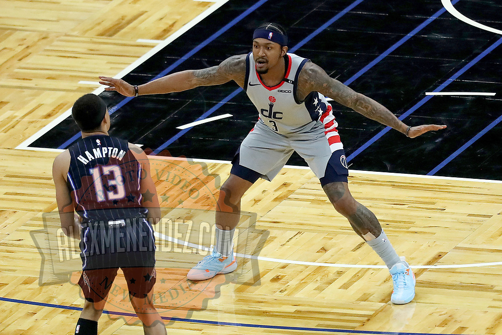 ORLANDO, FL - APRIL 07: Bradley Beal #3 of the Washington Wizards defends against R.J. Hampton #13 of the Orlando Magic during the second half at Amway Center on April 7, 2021 in Orlando, Florida. NOTE TO USER: User expressly acknowledges and agrees that, by downloading and or using this photograph, User is consenting to the terms and conditions of the Getty Images License Agreement. (Photo by Alex Menendez/Getty Images)*** Local Caption *** Bradley Beal; R.J. Hampton