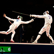 TOKYO, JAPAN - JULY 30:   Koki Kano of Japan. (left) in action against  Nikita Glazkov of ROC during the Japan V ROC gold medal match won by Japan 45-36  during the fencing epee team event for men at the Makuhari Messe at the Tokyo 2020 Summer Olympic Games on July 30, 2021 in Tokyo, Japan. (Photo by Tim Clayton/Corbis via Getty Images)