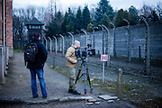 A camera team filming at the Auschwitz Nazi concentration camp. It is estimated that between 1.1 and 1.5 million Jews, Poles, Roma and others were killed in Auschwitz during the Holocaust in between 1940-1945.