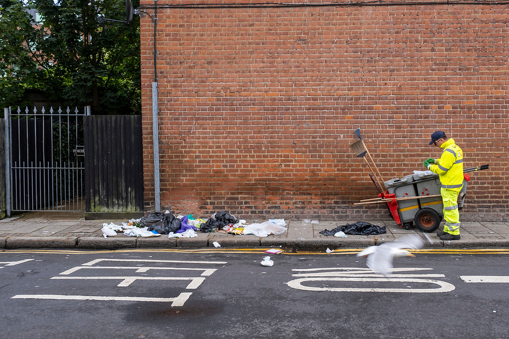 A Veolia street cleaner arrives at the scene of household waste bags that have been raided by foxes and seagulls overnight on the 1st of July 2020 in Folkestone, United Kingdom. (photo by Andrew Aitchison / In pictures via Getty Images)