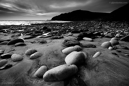 In this cove of high erosion from weather and huge Atlantic waves, arose order. Boulders rounded like giant eggs seemed so beautifully placed in the gritty dark sand, left perfectly even by the receding ocean