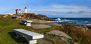 Concrete benches at the Nubble Light on a gorgeous afternoon, a classic New England lighthouse, York Maine, USA