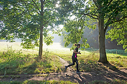 © Licensed to London News Pictures 16/09/2021. <br /> Sidcup, UK, A runner enjoying a bright start to her day. People out and about in the morning September sun at Footscray Meadows in Sidcup, South East London. Photo credit:Grant Falvey/LNP