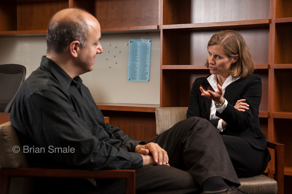 Liz Magill, dean of Stanford Law School, photographed by Brian Smale for Stanford Law Magazine, at Stanford Law campus, Neukom Building. Magill is meeting with outgoing Dean, Larry Kramer (left), in Dean's office.