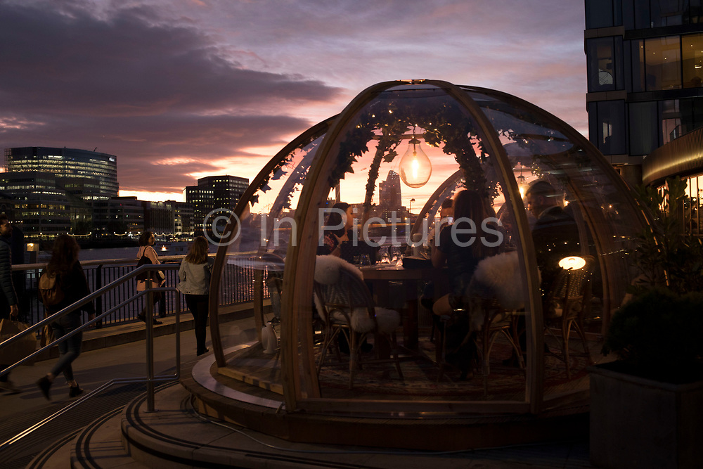 Pop up igloos being used for diners outside a hotel restaurant in London, England, United Kingdom.