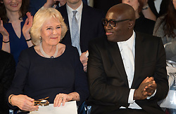 The Duchess of Cornwall (left) with British Vogue Editor Edward Enninful on the front row during a visit to London Fashion Week at the BFC Show Space, London.