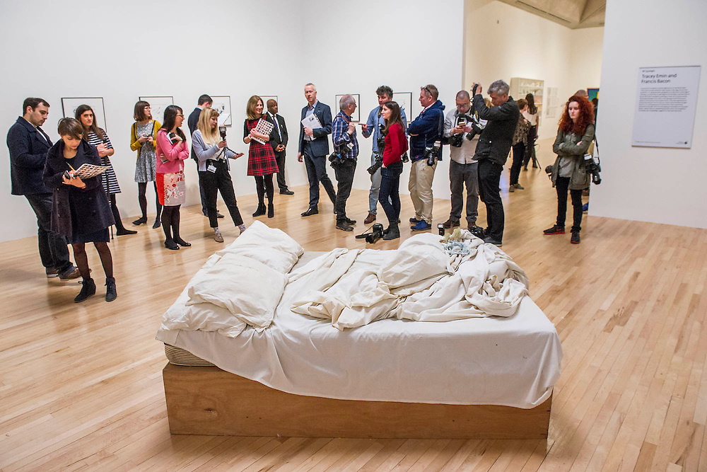 A new display including Tracey Emin's  My Bed 1998, in front of six of her recent figure drawings which have been gifted by the artist to the nation. My Bed 1998 became famous when it was shown in the 1999 Turner Prize exhibition, for which Emin was shortlisted. It was made in Tracey Emin's Waterloo council flat in 1998 and was referred to by the artist as an unconventional and uncompromising self-portrait through objects - featuring the artist's own bed covered in stained sheets, discarded condoms, underwear and empty bottles of alcohol. The piece gives a snapshot of the artist's life after a traumatic relationship breakdown. The Duerckheim Collection acquired the work in early July 2014 and it is now on loan to Tate for 10 years. <br /> <br /> The drawings and My Bed are positioned alongside two paintings by Francis Bacon, Study of a Dog 1952 and Reclining Woman 1961. And are part of a refresh of the galleries showing art from the 1970s to the present day - featuring major works by Gilbert & George, Anish Kapoor, Nicholas Pope and John Gerrard.