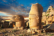 Image of the statues of around the tomb of Commagene King Antochus 1 on the top of Mount Nemrut, Turkey. Stock photos & Photo art prints. In 62 BC, King Antiochus I Theos of Commagene built on the mountain top a tomb-sanctuary flanked by huge statues (8–9 m/26–30 ft high) of himself, two lions, two eagles and various Greek, Armenian, and Iranian gods. The photos show the broken statues on the  2,134m (7,001ft)  mountain. 2 .<br /> <br /> If you prefer to buy from our ALAMY PHOTO LIBRARY  Collection visit : https://www.alamy.com/portfolio/paul-williams-funkystock/nemrutdagiancientstatues-turkey.html<br /> <br /> Visit our CLASSICAL WORLD HISTORIC SITES PHOTO COLLECTIONS for more photos to download or buy as wall art prints https://funkystock.photoshelter.com/gallery-collection/Classical-Era-Historic-Sites-Archaeological-Sites-Pictures-Images/C0000g4bSGiDL9rw
