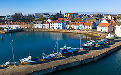 Aerial view from drone of harbour at St Monans fishing village in East Neuk of Fife, Scotland, UK