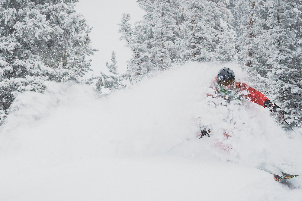 April showers bring late season powder days. Chris Smith skiing deep in the spring swing of things, Grizzly Gulch, Wasatch Range, Utah.