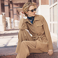 This image was photographed for the travel section of a fashion catalog. Jane is waiting for her companions to explore with her.