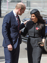 Meghan Markle, wearing a black Emilia Wickstead jacket and skirt and a Philip Treacy hat, is greeted by Prince William, Duke of Cambridge as they attend the Anzak Day service at Westminster Abbey in London on April 25, 2018.