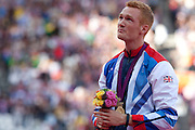 Mcc0041438 . Daily Telegraph..DT Sport..2012 Olympics..Team GB Long Jumper Greg Rutherford at the medal ceremony for the Gold he won last night ..5 August 2012....