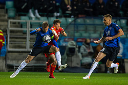 TALLINN, ESTONIA - Monday, October 11, 2021: Wales' Daniel James (R) is challenged by Estonia's captain Märten Kuusk during the FIFA World Cup Qatar 2022 Qualifying Group E match between Estonia and Wales at the A. Le Coq Arena. Wales won 1-0. (Pic by David Rawcliffe/Propaganda)