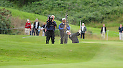 28-7-2011: Rory McIlroy driving out of a bunker on the 18th hole at the Irish Open in Killarney on Thursday..Picture by Don MacMonagle