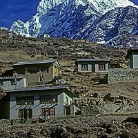HIMALAYA, NEPAL. Sherpa houses in Namche Bazaar, leading town of Khumbu region. 6,623m (21,729') Thamserku bkg.