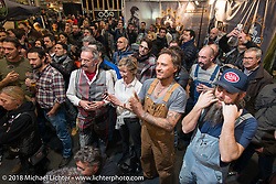 """A crowd enjoying the pole dancing in the """"I Santi Brecia"""" booth, which as far as I can tell, was just a fun cllub having a fun time at the Motor Bike Expo. Verona, Italy. January 23, 2016.  Photography ©2016 Michael Lichter."""