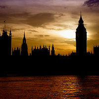 Silhouette of London skyline at sunset.