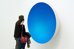 © Licensed to London News Pictures. 09/10/2012. LONDON, UK.  Two gallery visitors view Anish Kapoor's sculpture 'Inner Beauty' (2012) at a press view ahead of his new exhibition at the Lisson Gallery in London today (09/12/12) . The exhibition, the first since the artists solo exhibition at the Royal Academy of the Arts in 2009, features new works by Kapoor and runs from the 10th of October to the 10th of November 2012. Photo credit: Matt Cetti-Roberts/LNP