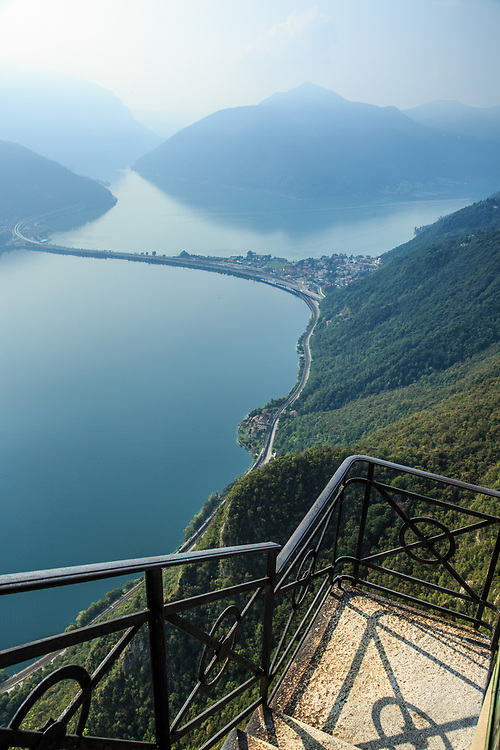 View of Lake Lugano from Monte San Salvatore, with the Melide causeway .