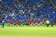 Players of both sides take the knee before the EFL Sky Bet Championship match between Cardiff City and Bristol City at the Cardiff City Stadium, Cardiff, Wales on 28 August 2021.