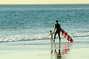 Dad Taking His Child Out Surfing