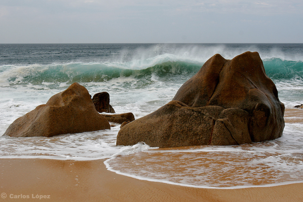 Two rocks in the shore of the beach in San cabo Lucas, Baja California, Mexico.