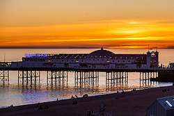 © Licensed to London News Pictures. 25/02/2019. Brighton, UK. The Brighton Palace Pier stands in front of a orange and red sky as the sun sets over Brighton and Hove. Photo credit: Hugo Michiels/LNP