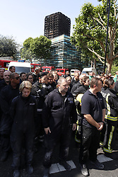 © Licensed to London News Pictures. 19/06/2017. London, UK. A minutes silence is held in Notting Hill for the victims of the Grenfell tower block fire. The blaze engulfed the 27-storey building killing dozens - with 34 people still in hospital, many of whom are in critical condition. Photo credit: Peter Macdiarmid/LNP