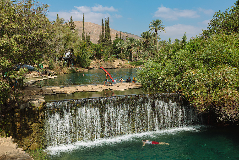 People enjoy a hot summer day at Gan HaShlosha National Park (also known by its Arabic name Sakhne), in northern Israel