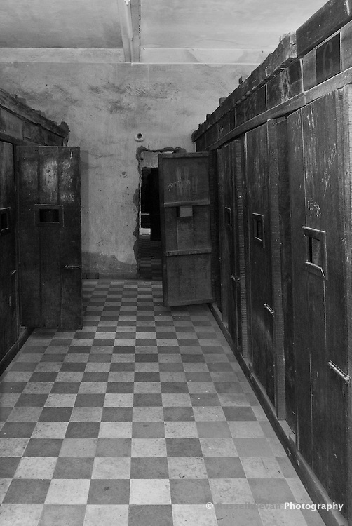 Wooden doors on the crude cells in Building C at Tuol Sleng Genocide Museum, Phnom Penh, Cambodia