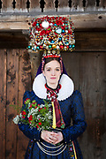 Sonja, member of the Trachtenverein St. Georgen, is wearing a traditional costume in Bleibach, Germany on April 7, 2018.