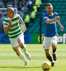 Rangers' Jason Holt goes past Celtic's Scott Brown during the Ladbrokes Scottish Premiership match at Celtic Park, Glasgow.