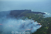 lava originating from Kilauea Volcano, erupting from fissure 8 in Leilani Estates, near Pahoa, flows through lower Puna District into Kapoho, approaching Kapoho Bay and Kapoho Tide Ponds (at upper right), Hawaii ( the Big Island ), Hawaiian Islands, U.S.A.; Cape Kumukahi Lighthouse is at top center; Kapoho Bay was filled in with lava the following day after this photo was taken; all the houses were eventually destroyed